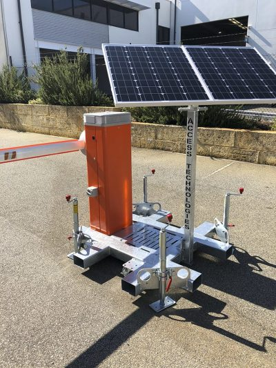 view of the solar panel and the SOLIS boom gate on the factory driveway